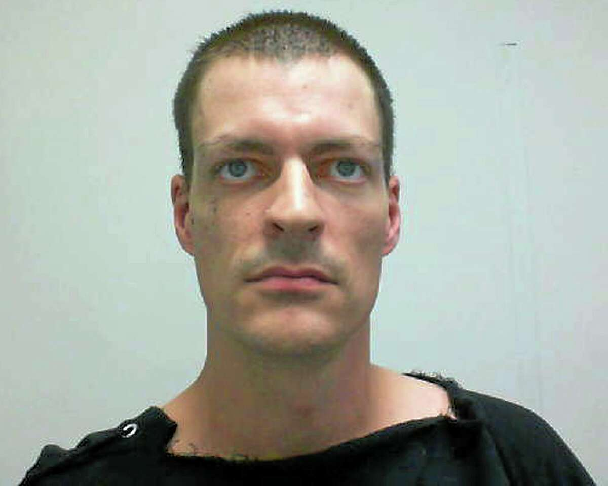 This booking photo released by the New Hampshire Attorney General's Office shows Nathaniel E. Kibby, 34, of Gorham, N.H., arrested Monday, July 28, 2014 and charged with one count of felony kidnapping of Abigail Hernandez, who went missing in Conway, N.H., in October 2013, and returned home last week. Kibby will be arraigned Tuesday in district court in Conway, N.H. (AP Photo/New Hampshire Attorney General's Office)