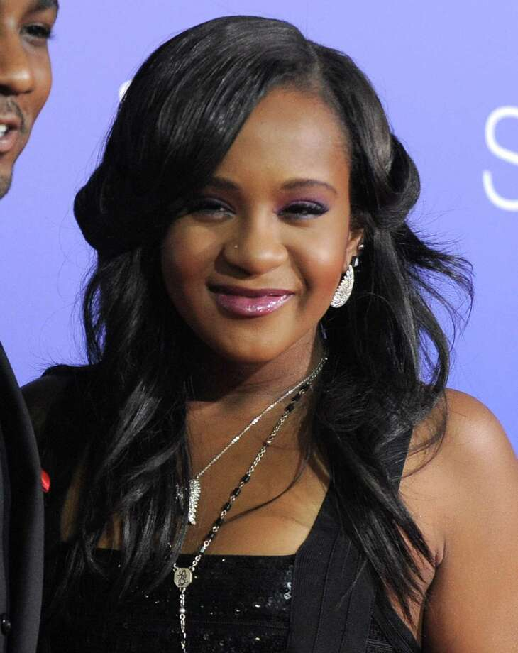 "FILE - In this Aug. 16, 2012, file photo, Bobbi Kristina Brown attends the Los Angeles premiere of ""Sparkle"" at Grauman's Chinese Theatre in Los Angeles. The daughter of the late singer and entertainer Whitney Houston, who was in hospice care after months of receiving medical care, died on Sunday, July 26, 2015. (Photo by Jordan Strauss/Invision/AP, File) Photo: Jordan Strauss/Invision/AP / Invision"