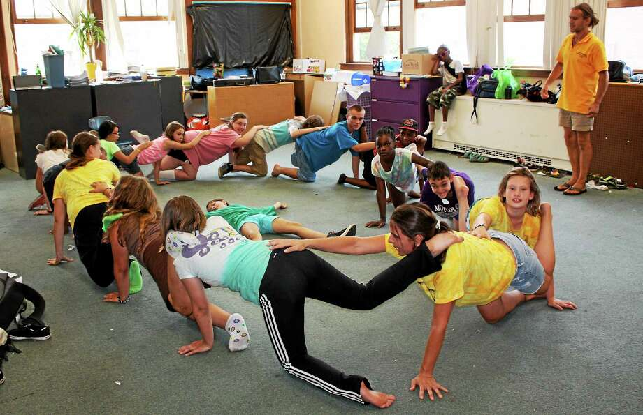 "The children of the NEAR Kids' Art summer camp rehearse for the ""Drought Monster,"" which premieres on July 30 at Macdonough School at 6 p.m. Photo: Submitted Photo"