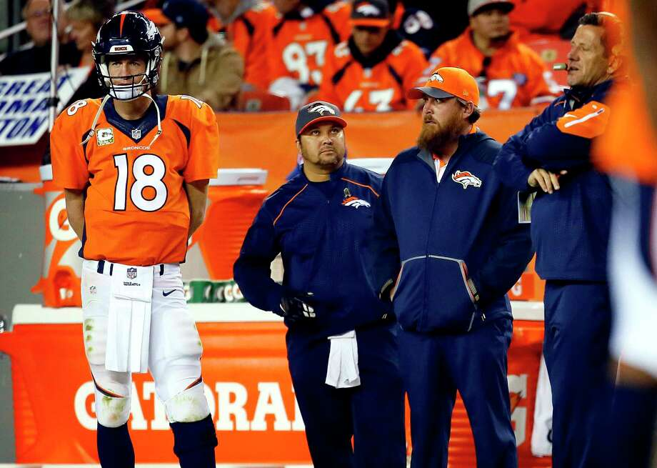 Broncos quarterback Peyton Manning watches from the sidelines during the second half against the Chiefs on Sunday. Photo: Joe Mahoney — The Associated Press  / FR170458 AP