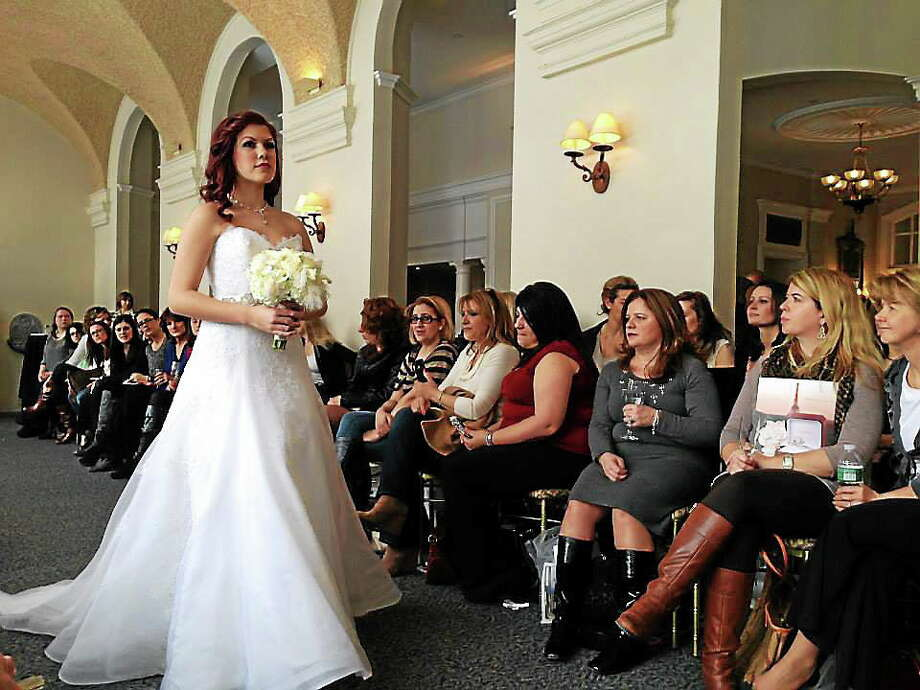 A model walks the catwalk in a dress from Mariella Creations in Rocky Hill for the Wadsworth Mansion's first ever bridal fashion show. Photo: Kaitlyn Schroyer — The Middletown Press
