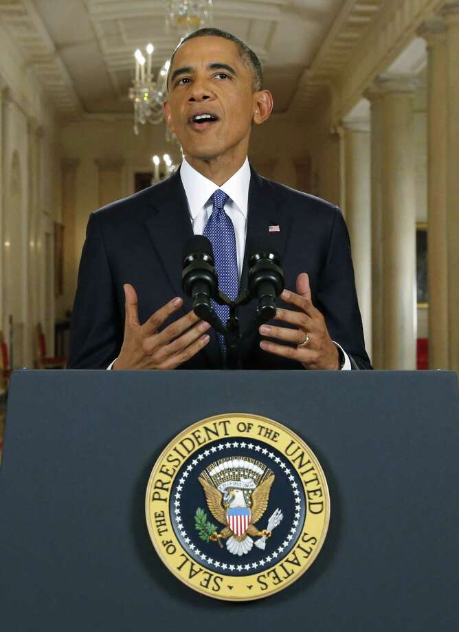 President Barack Obama announces executive actions on immigration during a nationally televised address from the White House in Washington, Thursday, Nov. 20, 2014. Obama outlined a plan on Thursday to relax U.S. immigration policy, affecting as many as 5 million people. Photo: (Jim Bourg — The Associated Press) / Reuters Pool