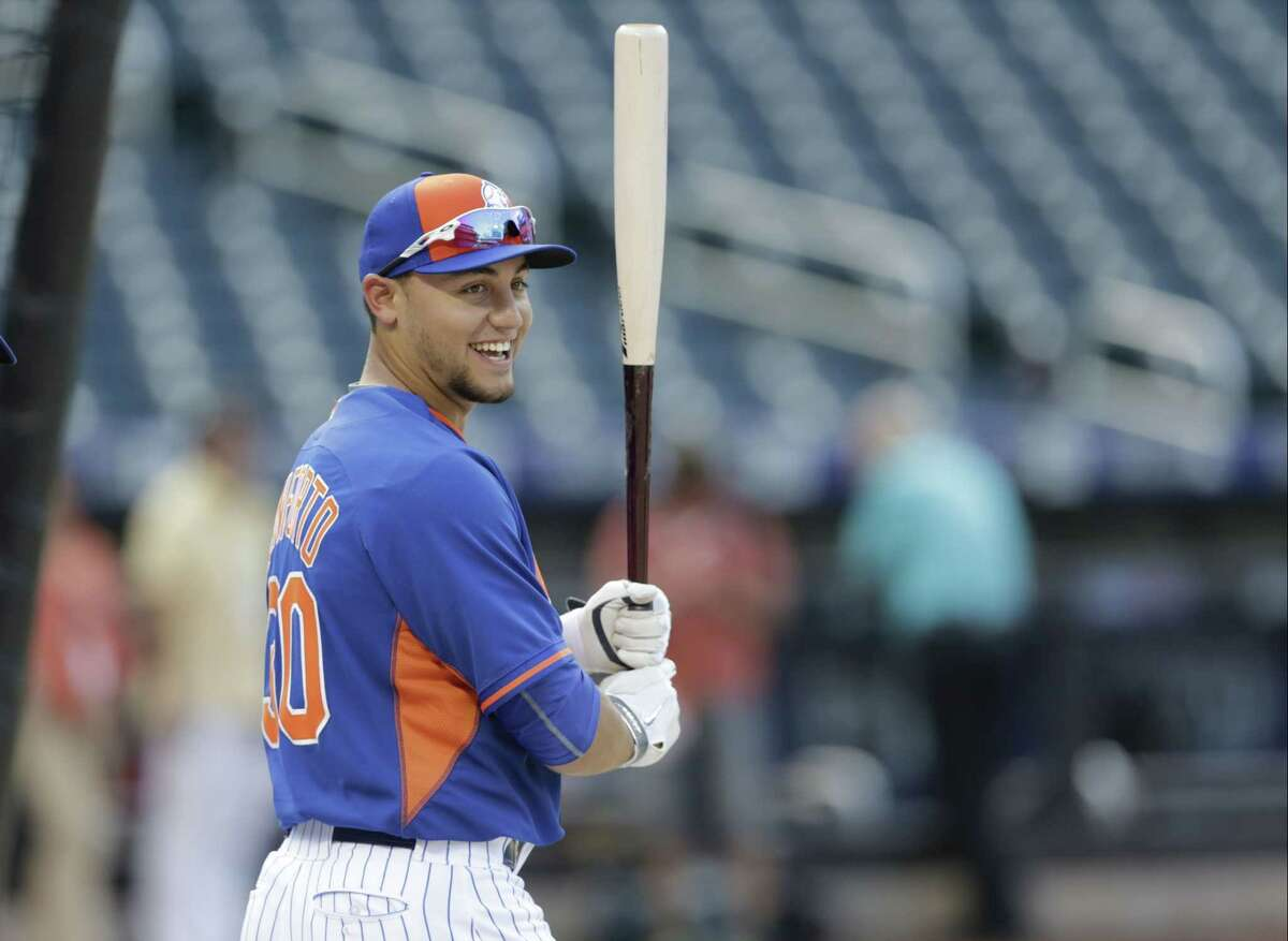 Mets rookie Michael Conforto warms up before his first major league game against the Los Angeles Dodgers on Friday night in New York.