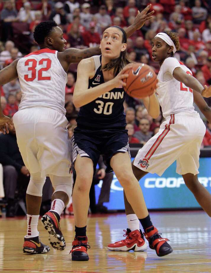 UConn's Breanna Stewart, center, drives to the basket between Ohio State's Shayla Cooper, left, and Alexa Hart during the first quarter Monday. Photo: Jay LaPrete — The Associated Press  / FR52593 AP
