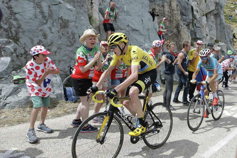 Chris Froome, wearing the overall leader's yellow jersey, and Italy's Vincenzo Nibali climb during during the twentieth stage of the Tour de France on Saturday. Photo: Laurent Cipriani — The Associated Press  / AP