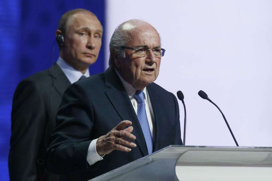 FIFA president Sepp Blatter speaks during the preliminary draw for the 2018 World Cup on Saturday in Konstantin Palace in St. Petersburg, Russia. Photo: Dmitry Lovetsky — The Associated Press  / AP
