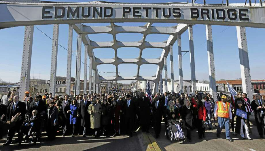 A group crosses the Edmund Pettus Bridge in Selma, Ala. Photo: AP Photo  / AP