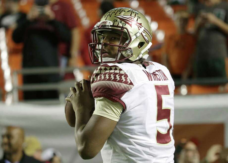 Florida State quarterback Jameis Winston warms up before a Nov. 15 game against Miami in Miami Gardens, Fla. Photo: Lynne Sladky — The Associated Press File Photo  / AP