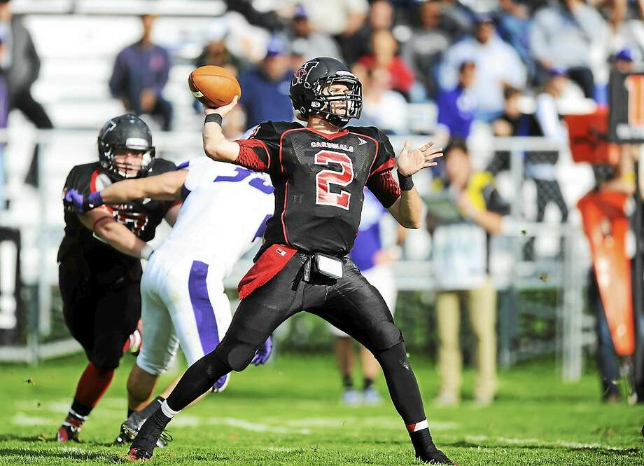 Wesleyan quarterback Jesse Warren was named the NESCAC's  Co-Offensive Player of the Year. Warren was second in the league in passing yards (1,513) and touchdowns (15) while leading the Cardinals to a 7-1 record. Photo: Photos Courtesy Of SteveMcLaughlinPhotography.com
