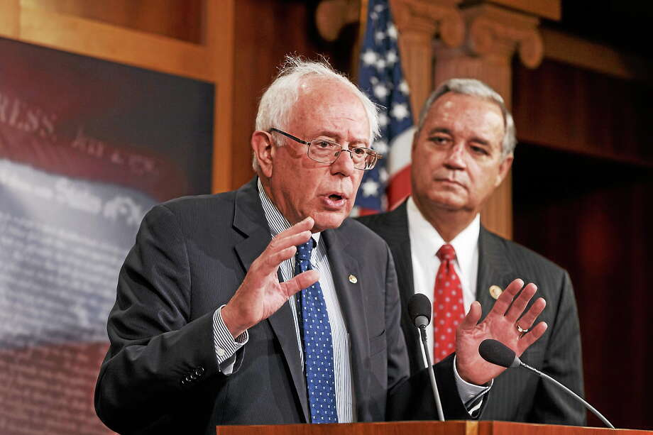 (AP Photo/J. Scott Applewhite) Senate Veteransí Affairs Chairman Sen. Bernie Sanders, I-Vt., left, accompanied by House Veteransí Affairs Chairman Rep. Jeff Miller, R-Fla., speaks during a news conference on Capitol Hill in Washington on July 28, 2014, to outline their agreement on a compromise plan to fix the vast health care system responsible for treating the nation's veterans. Photo: AP / AP