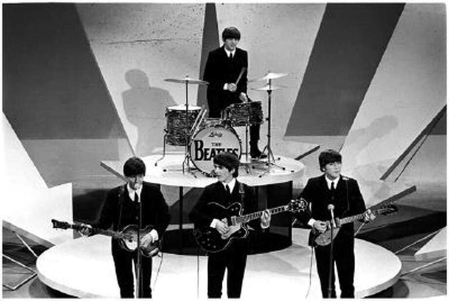 The Beatles perform on The Ed Sullivan Show, on Feb. 9, 1964.