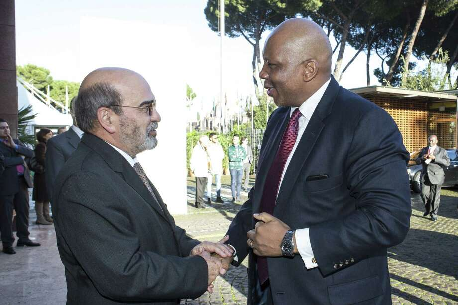 FAO Director-General Jose Graziano Da Silva, left, greets H.R.M. King Letsie III of Lesotho. prior to the opening session of the United Nations Food and Agriculture Organization (FAO) second International Conference on Nutrition, in Rome on Nov. 19, 2014. More than 170 governments pledged Wednesday to do more to prevent malnutrition around the globe. Photo: AP Photo/Alessandra Benedetti/FAO  / AP