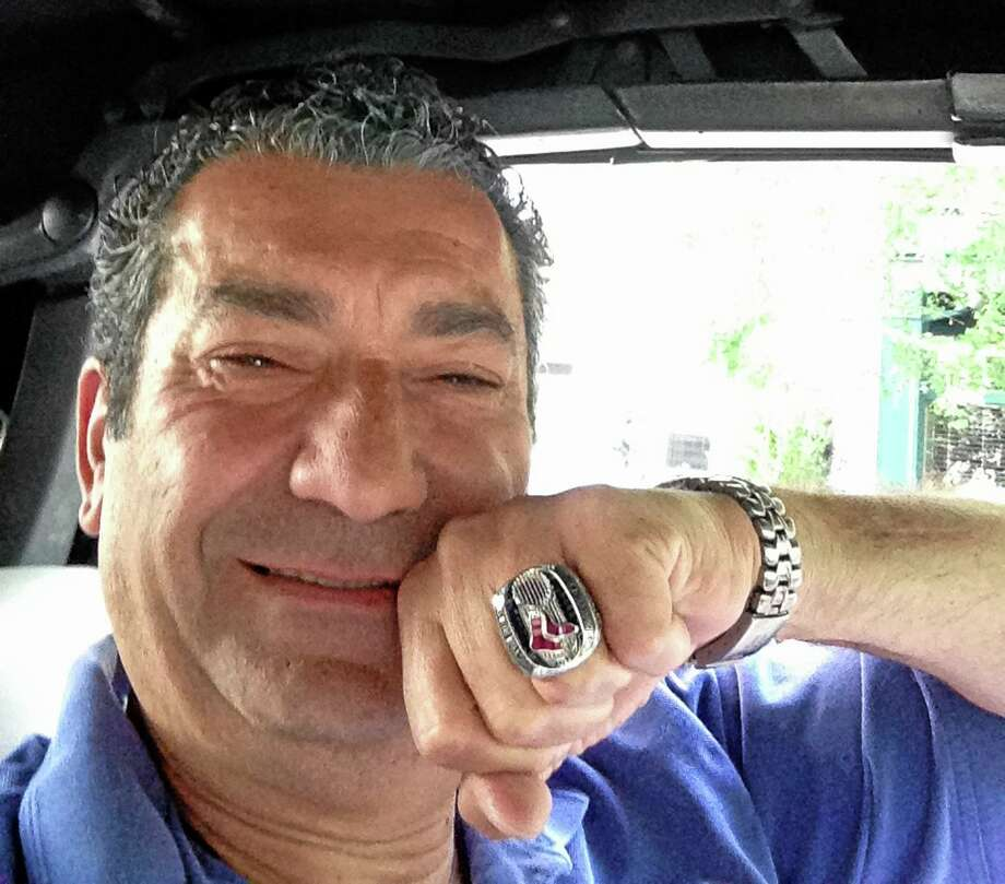 New York Yankees fan Militello displays the 2013 Red Sox World Series ring he found at his New York restaurant on Thursday night. Militello returned the ring on Friday to Drew Weber, who owns one of Boston's minor league teams. Photo: The Associated Press  / Luigi Militello