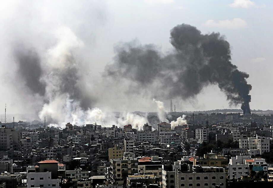 Smoke from Israeli strikes rise over Gaza City, in the northern Gaza Strip on July 27, 2014. Photo: AP Photo/Adel Hana  / AP