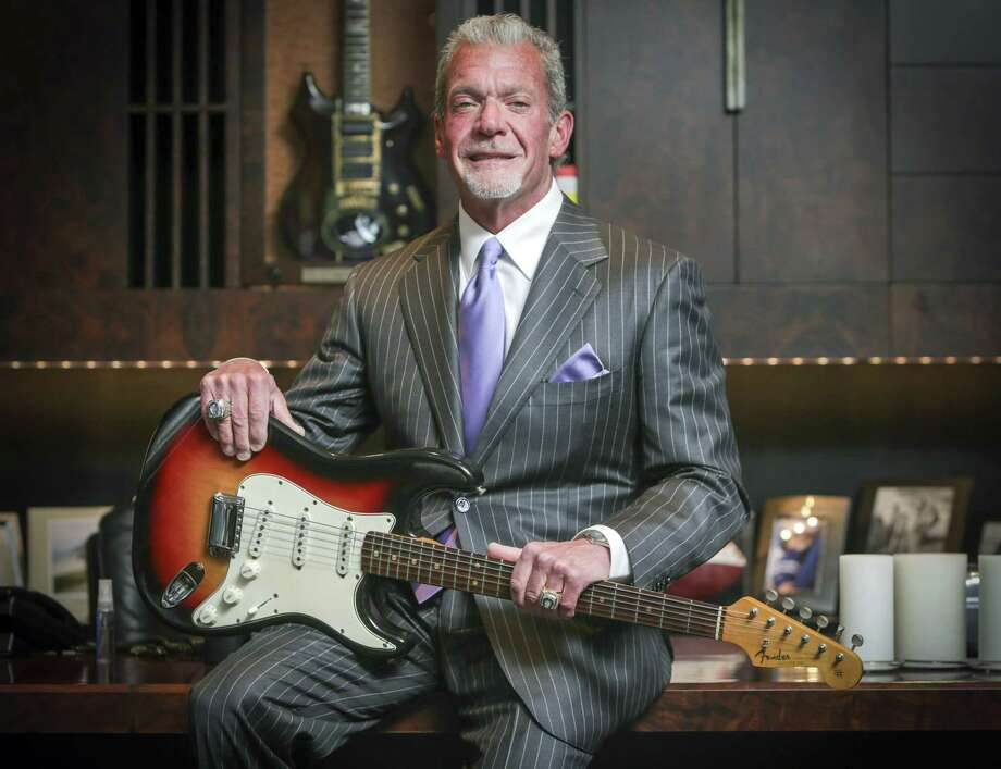 In this June 10, 2014, file photo, Indianapolis Colts owner and CEO Jim Irsay holds in Indianapolis the Fender Stratocaster guitar that Bob Dylan played at the Newport Folk Festival in 1965. Irsay purchased it at auction for just under $1 million. Photo: Michelle Pemberton/The Indianapolis Star Via AP / The Indianapolis Star