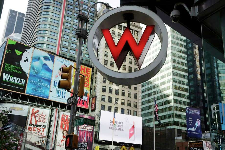 In this July 31, 2013 photo, the logo for the W Hotel, owned by Starwood Hotels & Resorts Worldwide, is seen in New York's Times Square. Photo: AP Photo/Mark Lennihan, File  / AP
