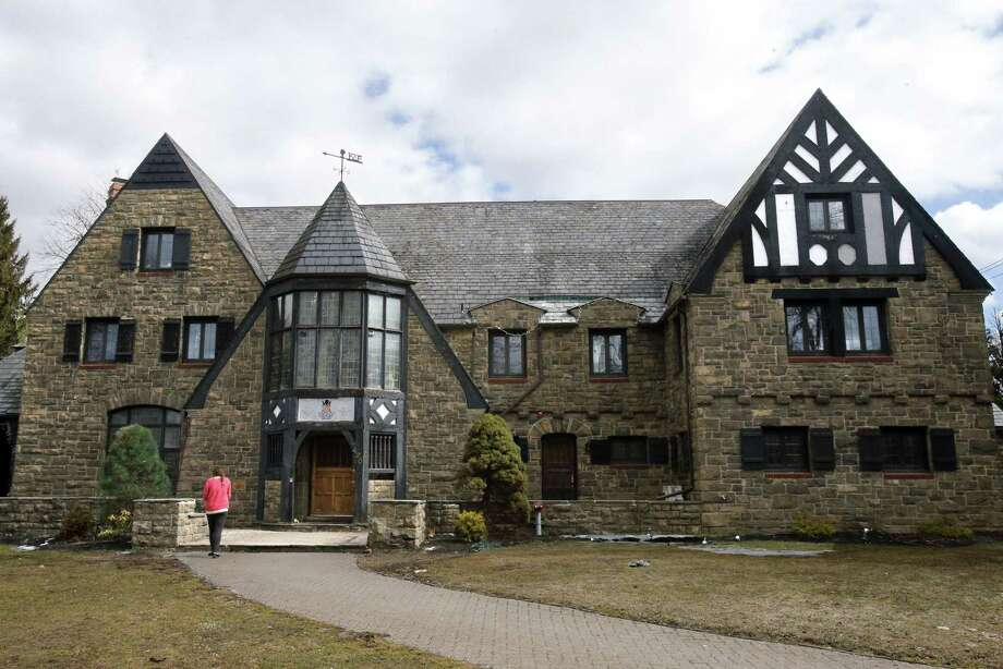 A reporter walks up to the front door of the Kappa Delta Rho fraternity house Tuesday, March 17, 2015, at Penn State University in State College, Pa.  The fraternity has been suspended as police investigate allegations that members used a private, invitation-only Facebook page to post photos of nude and partly nude women in sexual and other embarrassing positions, some apparently asleep or passed out. (AP Photo/Gene J. Puskar) Photo: AP / AP