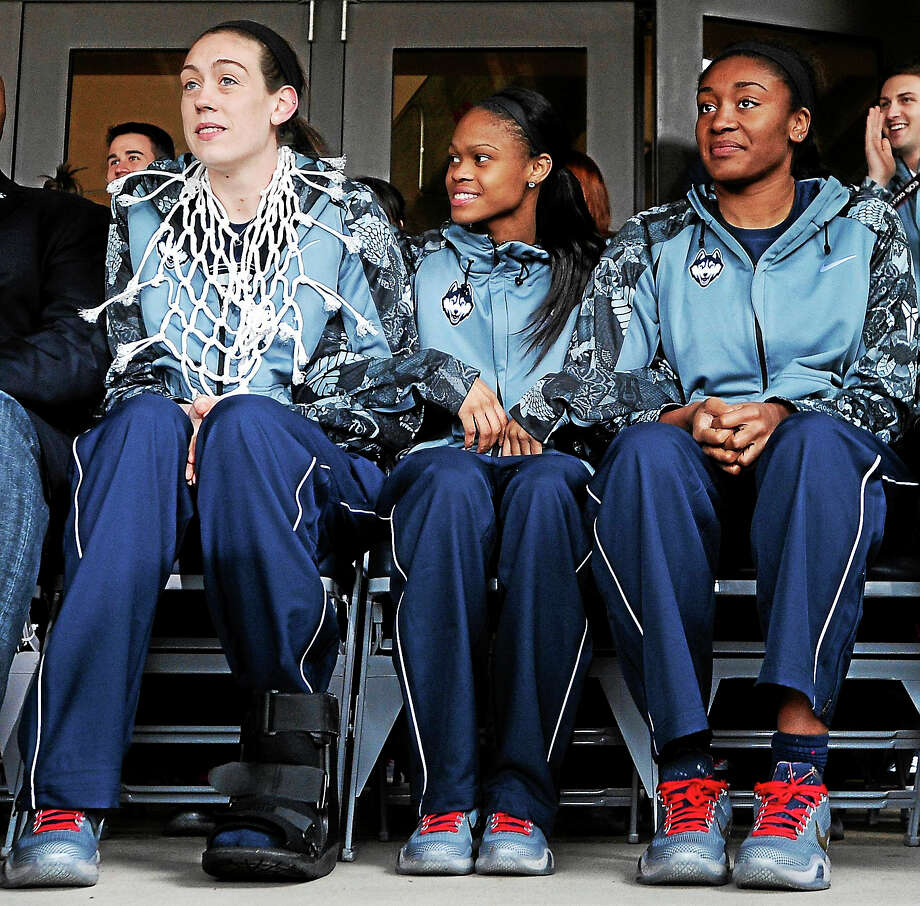Led by Breanna Stewart, left, Moriah Jefferson, center and Morgan Tuck, the UConn women's basketball enters the season with a chance to win a fourth consecutive national championship. Photo: The Associated Press File Photo  / FR125654 AP