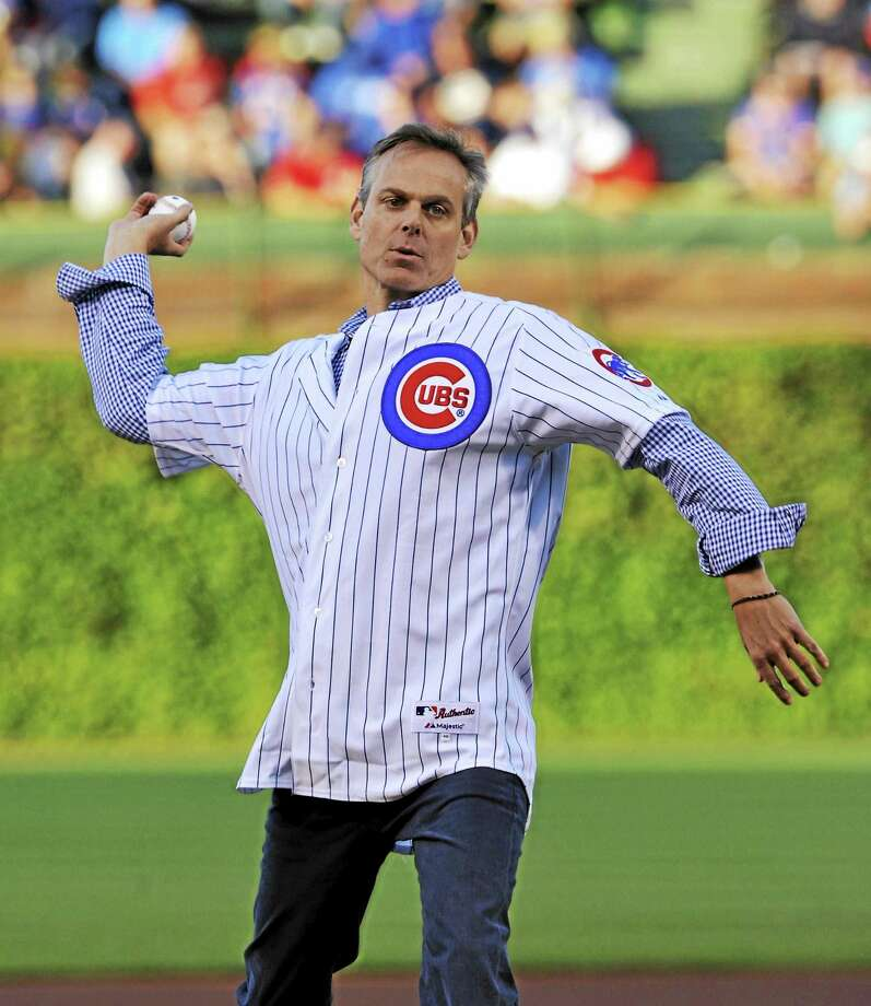 Colin Cowherd tosses out the first pitch before a Reds-Cubs game in 2013 in Chicago. Photo: Jim Prisching — The Associated Press  / FR59933 AP