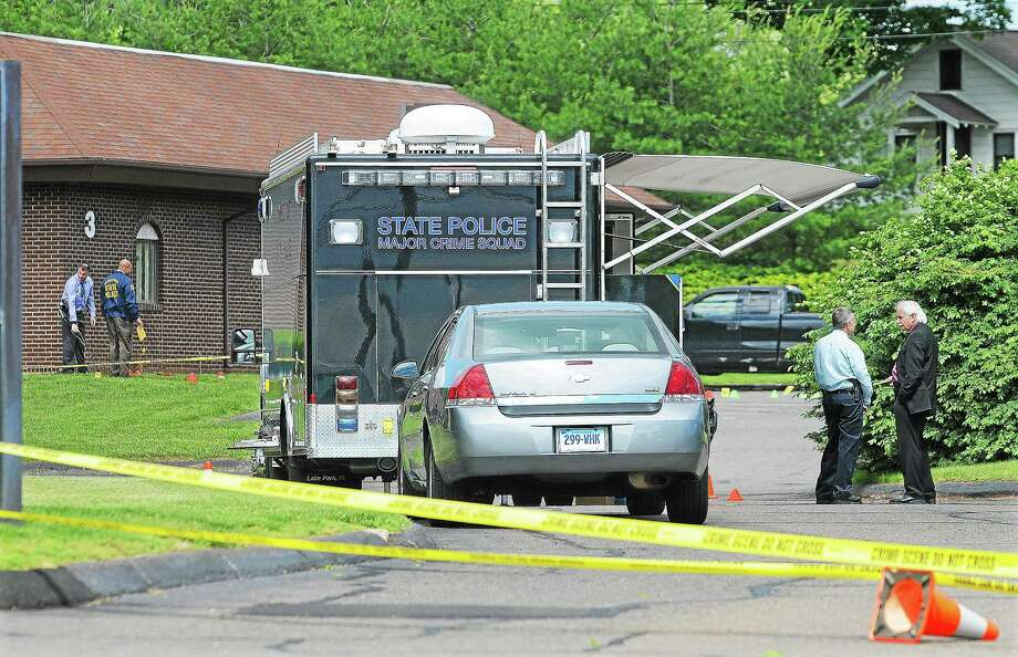 Connecticut State Police investigate the scene where a Cromwell man was shot and wounded by a police officer after crashing his Ford pickup truck into a medical building on the corner of West and Washington streets in this 2013 file photo. Photo: File Photo  / TheMiddletownPress