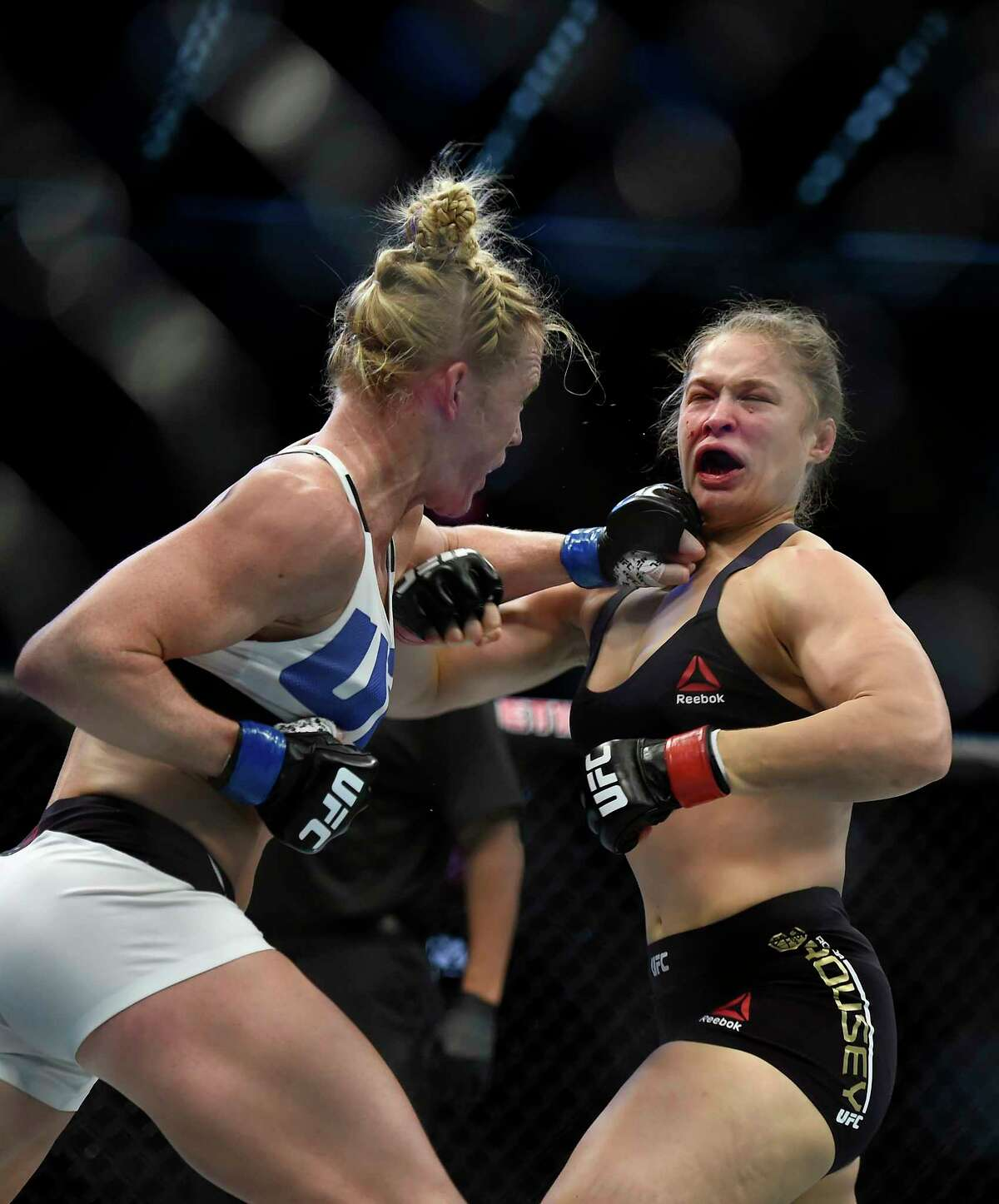 Holly Holm, left, punches Ronda Rousey during their UFC 193 bantamweight title fight in Melbourne, Australia.