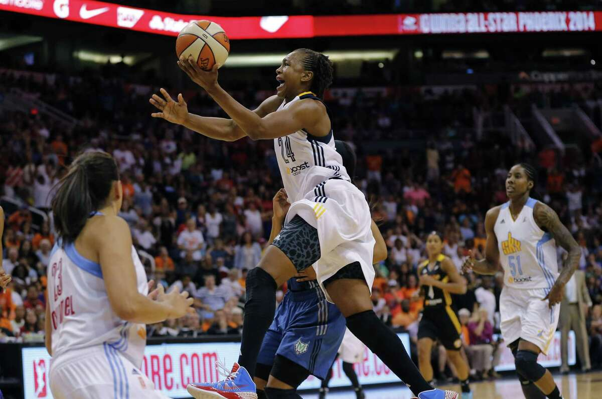 The Eastern Conference's Tamika Catchings, of the Indiana Fever, scores the winning basket during overtime of the 2014 WNBA All-Star Game. Catchings will be playing in a record 10th WNBA All-Star Game today at Mohegan Sun Arena in Uncasville.
