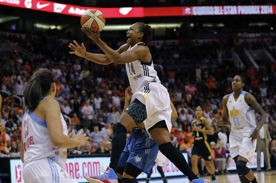 The Eastern Conference's Tamika Catchings, of the Indiana Fever, scores the winning basket during overtime of the 2014 WNBA All-Star Game. Catchings will be playing in a record 10th WNBA All-Star Game today at Mohegan Sun Arena in Uncasville. Photo: Matt York — The Associated Press File Photo  / AP