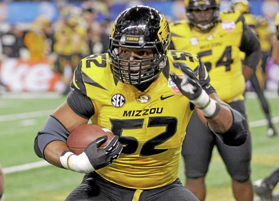 In this Jan. 3 photo, Missouri defensive lineman Michael Sam (52) warms up before the Cotton Bowl NCAA college football game against Oklahoma State, in Arlington, Texas.  THE ASSOCIATED PRESS Photo: AP / FR62992 AP