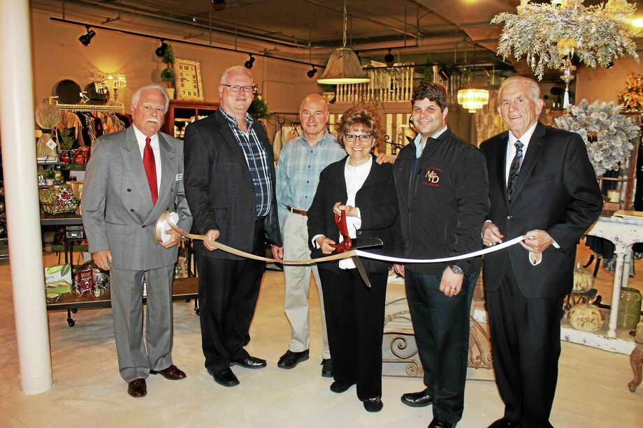A Pocketful of Posies is a new gift shop in Main Street Market. From left, shown at the grand opening, are Middletown Small Business Development Center Counselor Paul Dodge, Chamber Central Business Bureau Chairman Tom Byrne, Bill and Dottie Smith of A Pocketful of Posies, Middletown Mayor Dan Drew and Chamber President Larry McHugh. Photo: Courtesy Photo