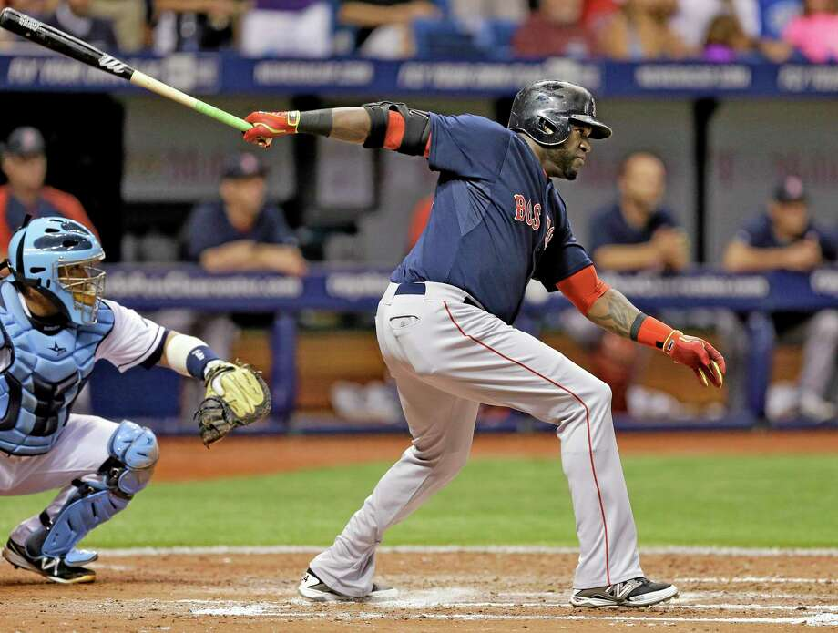 Boston Red Sox designated hitter David Ortiz hits an RBI single off Tampa Bay Rays starter David Price during the sixth inning of Friday night's game in St. Petersburg, Fla. While Boston legend Carl Yastrzemski calls Big Papi the second-best Red Sox hitter of all time behind only Ted Williams, Register sports columnist Chip Malafronte says Yaz, with his seven Gold Gloves, is still clearly the better player. Photo: Chris O'Meara — The Associated Press  / AP