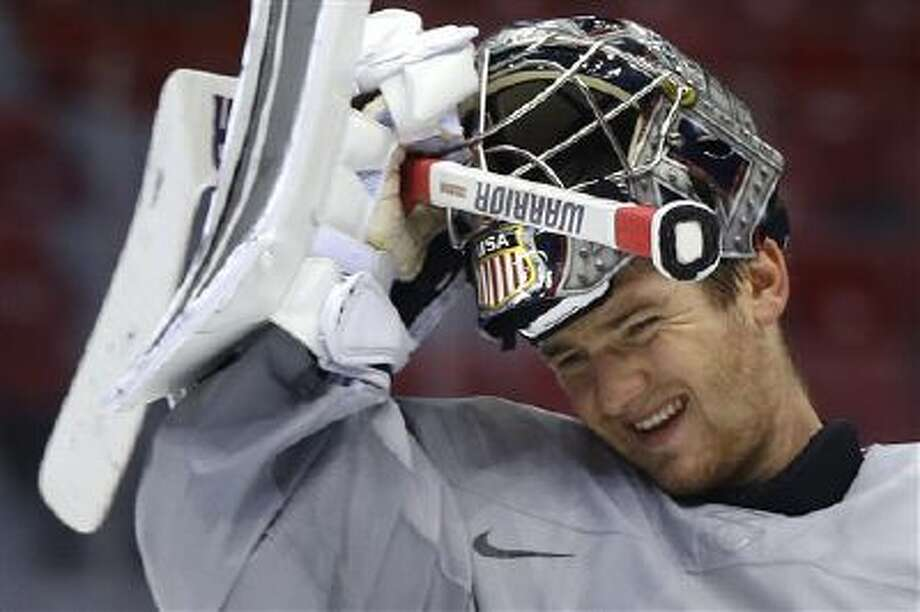 USA goaltender Jonathan Quick pulls his helmet down during a training session at the 2014 Winter Olympics, Monday, Feb. 10, 2014, in Sochi, Russia. Photo: AP / AP