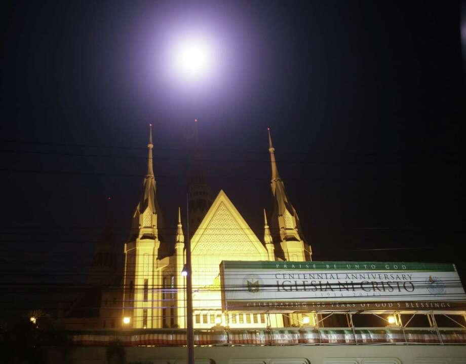 In this photo taken July 23, 2015, the central temple of the Iglesia Ni Cristo or Church of Christ is seen in suburban Quezon city northeast of Manila, Philippines. A politically influential and secretive Christian church that's involved in a legal dispute with American R&B singer Chris Brown has been caught in a rising tide of its own legal troubles. (AP Photo/Bullit Marquez) Photo: AP / AP