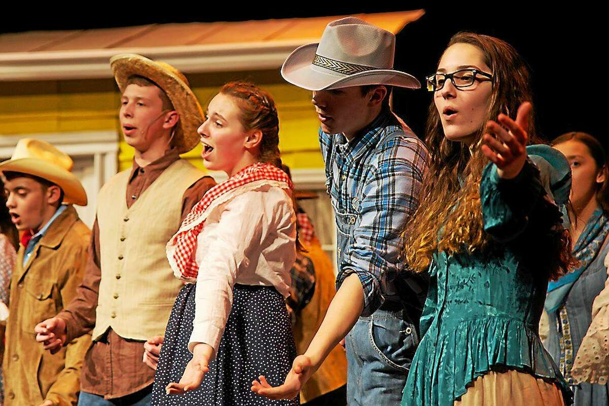 """CONTRIBUTED PHOTO BY STUART NOELTE Josh Arroyo, Nick Coman, Emily Bradshaw, Roland Thivierge and Nicole DiMare rehearse a scene from Portland High School's """"Oklahoma!"""""""