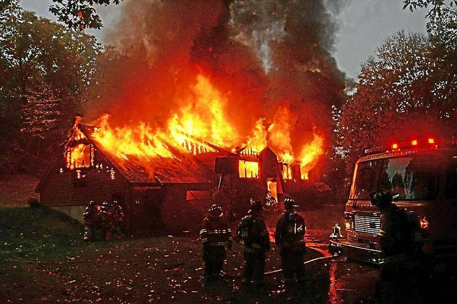 "Firefighters from nine departments in Middlesex County worked to contain a house blaze Oct. 17 <a href=""http://www.middletownpress.com/general-news/20141016/devastating-haddam-house-fire-deemed-suspicious"">in Higganum</a>. Photo: Courtesy Haddam Volunteer Fire Co."