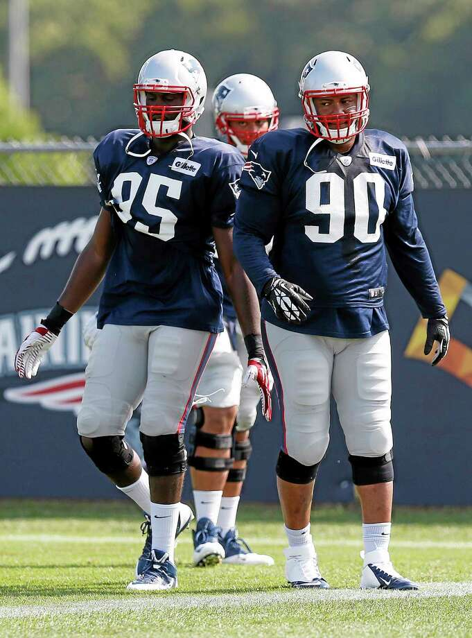New England Patriots defensive end Chandler Jones (95) and linebacker Will Smith prepare to run a drill during Saturday's practice in Foxborough, Mass. Photo: The Associated Press  / AP
