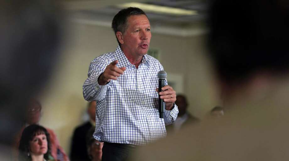 Republican presidential candidate Ohio Gov. John Kasich addresses a gathering at a town hall style meeting during a campaign stop in Greenland, N.H., Wednesday. Photo: AP Photo  / AP