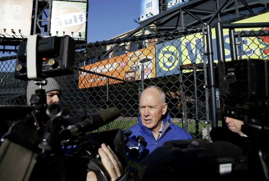 New York Mets general manager Sandy Alderson speaks to the media in the outfield of Citi Field on Tuesday in New York. The Mets are moving their fences in for the second time. Photo: Seth Wenig — The Associated Press  / AP