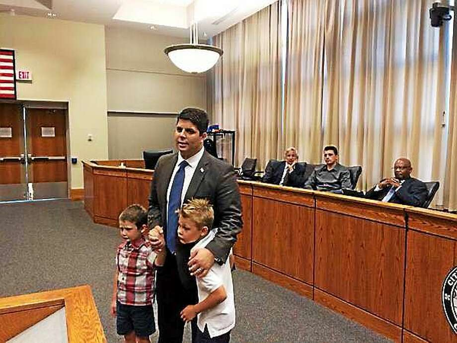 Middletown Mayor Dan Drew, with his sons Jacob and Jackson by his side, accepts his party's nomination at the town committee meeting in council chambers on Thursday evening. Photo: Courtesy Shawn Beals/hartford Courant