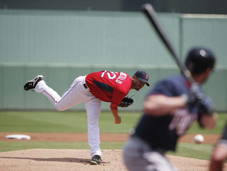 Boston Red Sox starter Rick Porcello delivers against the Minnesota Twins during the first inning of a spring training game on Wednesday in Fort Myers, Fla. Photo: Brynn Anderson — The Associated Press  / AP