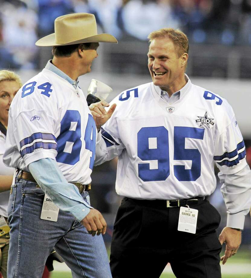 Former Dallas Cowboys defensive lineman Chad Hennings, right, is the recipient of the 2014 Walter Camp Football Foundation Alumni Award. At left is Jay Novacek. Photo: Sharon Ellman — The Associated Press File Photo  / AP2010