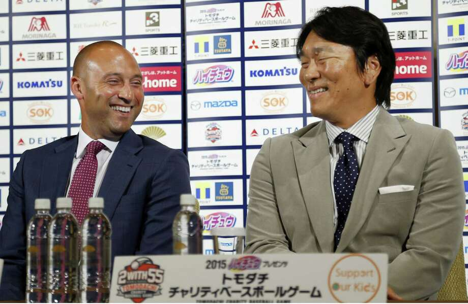 Former New York Yankees shortstop Derek Jeter, left, and outfielder Hideki Matsui are teaming up to support the survivors of the 2011 earthquake and tsunami with a charity game on Sunday at Tokyo Dome. Photo: Shizuo Kambayashi — The Associated Press  / AP