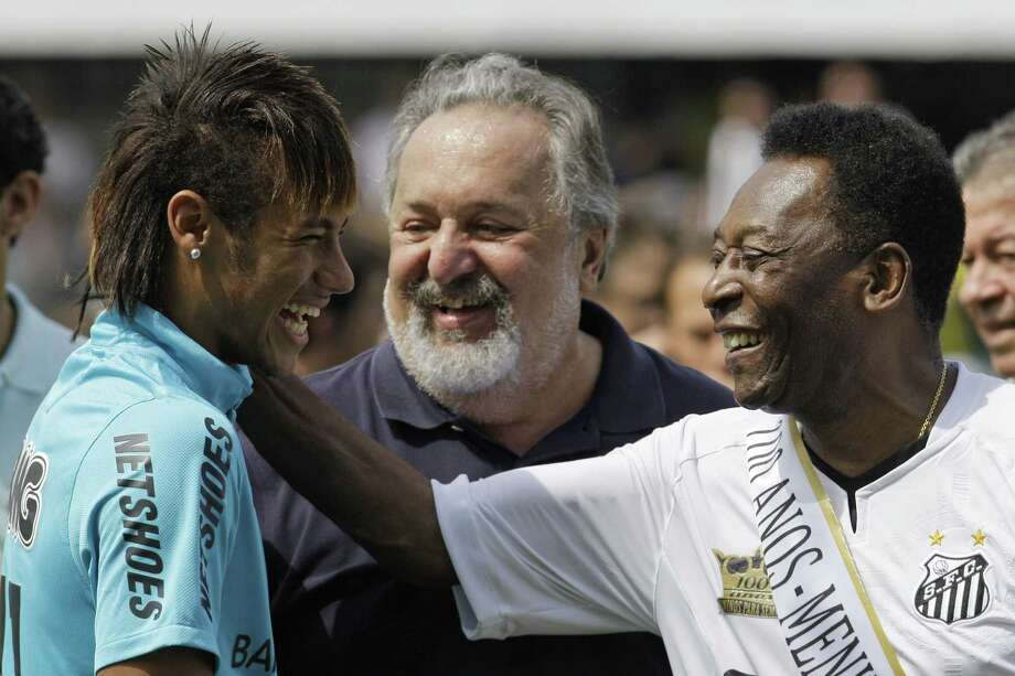 In this April 14, 2012 file photo, soccer player Neymar, left, and former soccer player Pele, right, share a laugh during the centennial anniversary celebration of the team in Santos, Brazil. Photo: Nelson Antoine — The Associated Press File Photo  / AP