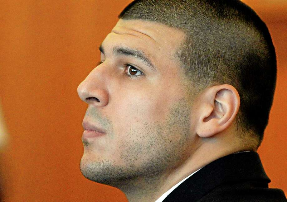 Aaron Hernandez watches during a hearing in Bristol County Superior Court Tuesday in Fall River, Mass. Photo: CJ Gunther — The Associated Press  / Pool, EPA