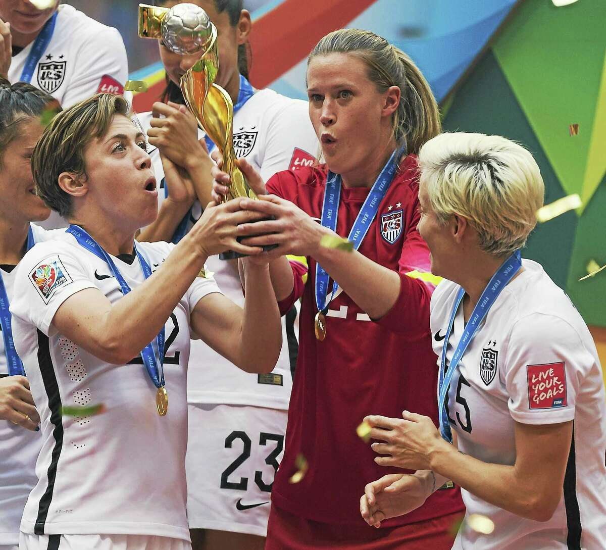 Seymour's Alyssa Naeher, in red, celebrates after the United States Women's National Team's 5-2 victory over Japan in the World Cup final on July 5 in Vancouver, British Columbia.