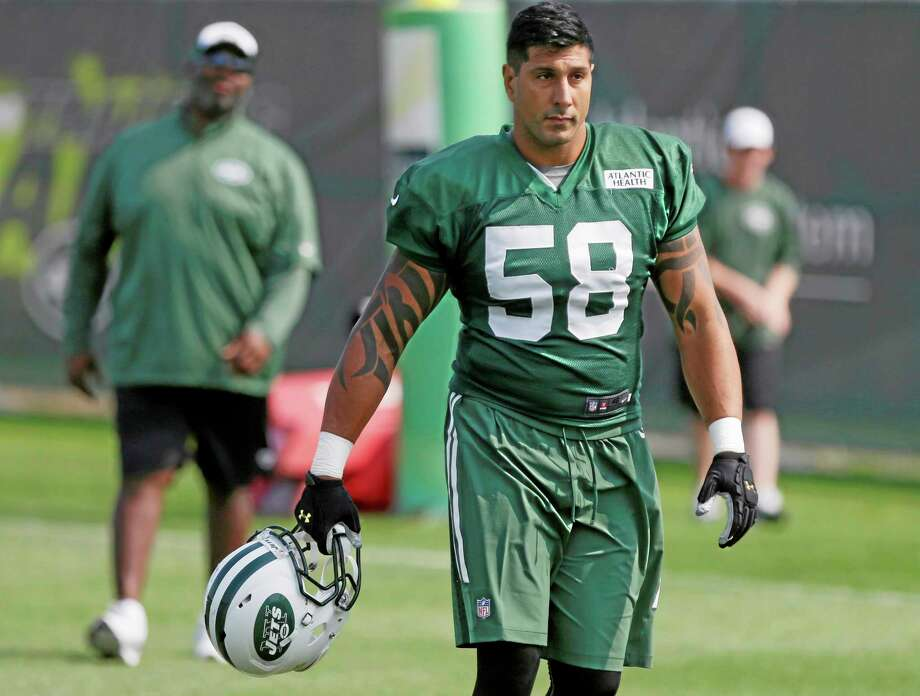 The Associated Press New York Jets linebacker Jason Babin (58) walks on the field at practice Friday in Cortland, N.Y. Photo: AP / AP