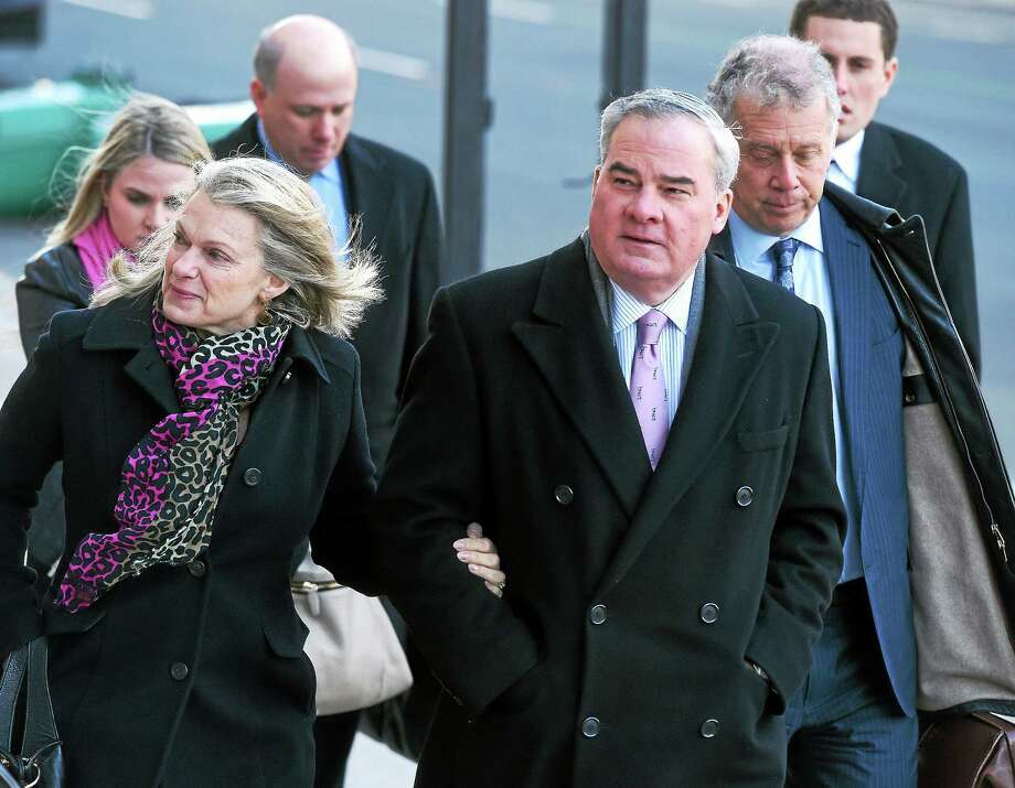 (Arnold Gold-New Haven Register)  Former Connecticut Governor John Rowland (right) walks into Federal Court in New Haven for sentencing with his wife, Patty, on 3/18/2015. Photo: Journal Register Co.