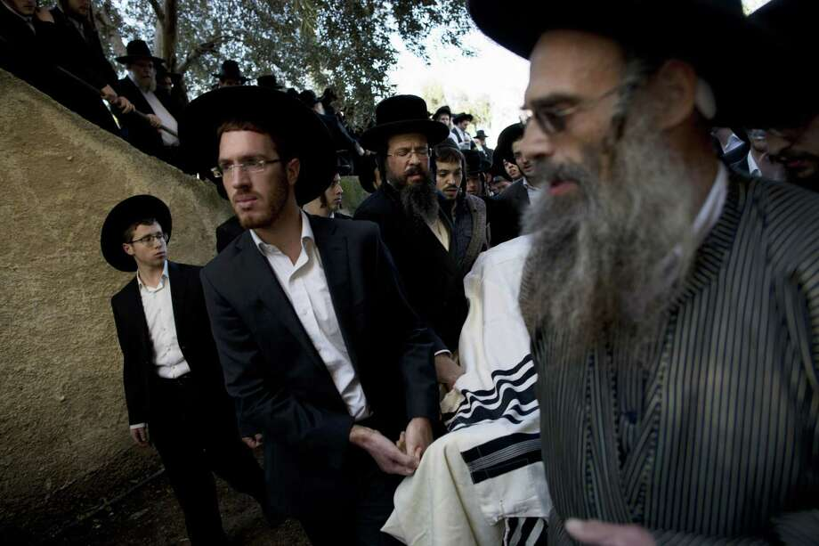 Ultra-Orthodox Jews carry the body of Mosheh Twersky during his funeral in Jerusalem, Tuesday, Nov. 18, 2014. (AP Photo/Oded Balilty) Photo: AP / AP