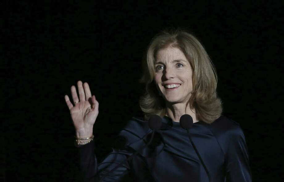 U.S. Ambassador to Japan Caroline Kennedy waves before she delivers opening remarks during JFK International Symposium at Waseda University in Tokyo Wednesday, March 18, 2015. Japanese police are investigating phone calls threatening to kill U.S. Ambassador Kennedy. (AP Photo/Eugene Hoshiko) Photo: AP / AP
