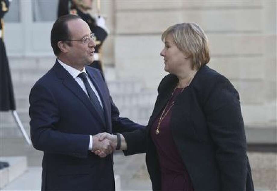 France's President Francois Hollande, left, welcomes Norway's Prime Minister Erna Solberg for a meeting Monday at the Elysee Palace in Paris. Photo: AP / AP