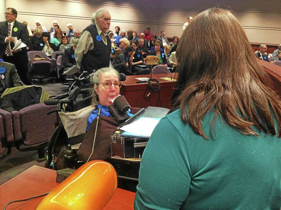 Cathy Ludlum of Manchester, left, a member of Second Thoughts Connecticut, opposes the aid-in-dying bill before the General Assembly's Judiciary Committee. Photo: Ed Stannard — New Haven Register